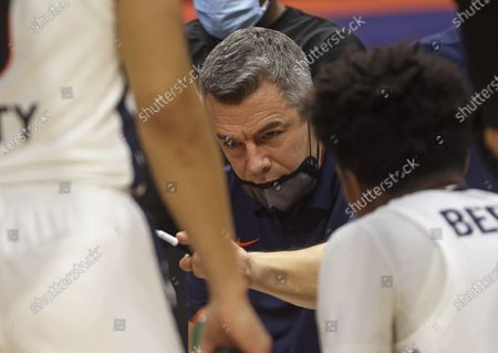 Virginia coach Tony Bennett talks with his players in a huddle during the team's NCAA college basketball game against North Carolina State, in Charlottesville, Va