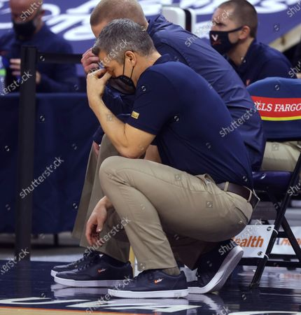 Virginia coach Tony Bennett reacts to a play during the team's NCAA college basketball game against North Carolina State, in Charlottesville, Va