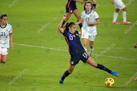 United States forward Alex Morgan (13) controls a ball in front of Argentina defender Adriana Sachs (21) and midfielder Valentine Camara (17) during the second half of a SheBelieves Cup women's soccer match, in Orlando, Fla