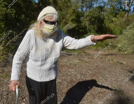 Local resident Janet Engelman, 82, is seen in the area where golf legend Tiger Woods rolled his car after crossing a median in Rolling Hills Estates, California on Wednesday, February 24, 2021. Engelman told the photographer she had safely transported her five children up and down Hawthorne Blvd. for decades. Experts say Tiger Woods has a long way to go in his recovery process from the broken leg, ankle and foot injuries he sustained in a car crash Tuesday in Southern California