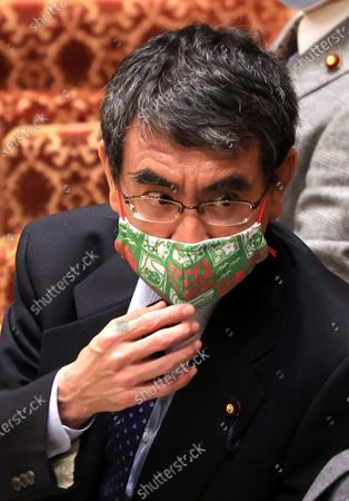 Japanese Administrative Reform Minister Taro Kono listens to a question at Lower House's budget committee session at the National Diet in Tokyo on Thursday, February 25, 2021. Prime Minister Yoshihide Suga's son Seigo provided dinners and gifts for communications ministry bureaucrats in violations of the national public service ethics law.