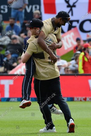 Stock Photo of New Zealand's Ish Sodhi is lifted by his teammate Jimmy Neesham as they celebrate the dismissal of Australia's Glenn Maxwell