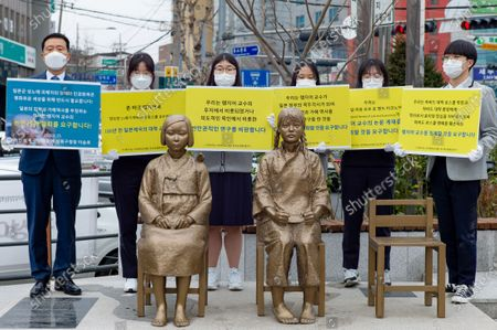 The students of the Gyeongseong High School and Lee Seung-ro, the head of Seongbuk-gu, Seoul, hold a press conference in front of the Statue of Peace in Seongbuk-gu, Seoul on February 25, 2021 in Seoul, South Korea. They condemned Harvard law school professor John Mark Ramseyer of Harvard University, who wrote a paper claiming that the comfort women were prostitutes.