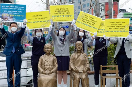 Stock Image of The students of the Gyeongseong High School and Lee Seung-ro, the head of Seongbuk-gu, Seoul, hold a press conference in front of the Statue of Peace in Seongbuk-gu, Seoul on February 25, 2021 in Seoul, South Korea. They condemned Harvard law school professor John Mark Ramseyer of Harvard University, who wrote a paper claiming that the comfort women were prostitutes.