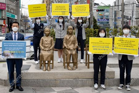 Stock Photo of The students of the Gyeongseong High School and Lee Seung-ro, the head of Seongbuk-gu, Seoul, hold a press conference in front of the Statue of Peace in Seongbuk-gu, Seoul on February 25, 2021 in Seoul, South Korea. They condemned Harvard law school professor John Mark Ramseyer of Harvard University, who wrote a paper claiming that the comfort women were prostitutes.