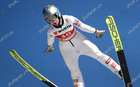 Austria's Sophie Sorschag soars through the air during the women's ski jumping normal hill individual trail round at the FIS Nordic World Ski Championships in Oberstdorf, Germany