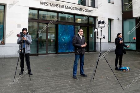 Journalists report the verdict to allow the extradition of Nirav Modi, outside Westminster Magistrates Court, in London, . Diamond tycoon Nirav Modi has lost his bid to avoid extradition from Britain to India to face allegations he was involved in a $1.8 billion bank fraud. District Judge Samuel Goozee ruled in London on Thursday that the jeweler has a case to answer before the Indian courts