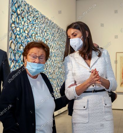 German art collector Helga de Alvear (L) holds Spanish Queen Letizia's arm during the inauguration of Helga de Alvear Foundation's New Contemporary Art Museum in Caceres city, Extremadura region, western Spain, 25 February 2021. The museum opens its doors with 200 pieces of contemporary art, including the lamp 'Descending Light' of Chinese artist and activist Ai WeiWei (1957), some of the 'Caprichos' by Spanish artist Francisco de Goya (1746-1828) and works by Pablo Ruiz Picasso (1881-1973), Danish-Icelandic artist Oleafur Eliasson (1967) and Russian Vasili Kandinsky (1866-1944), among others, which will make Caceres city a benchmark for contemporary art.