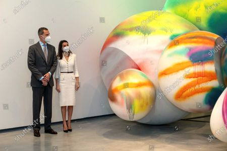 Spain's King Felipe VI (L) and Queen Letizia observe an installation by US artist Tony Oursler during the inauguration of Helga de Alvear Foundation's New Contemporary Art Museum in Caceres, Spain, 25 February 2021. The museum opens its doors with 200 important contemporary artworks making Caceres a benchmark for contemporary art.