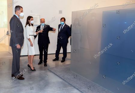 Stock Photo of Extremadura's regional president Guillermo Fernandez Vara (R), trustee of the Helga de Alvear Foundation Jose Maria Vinuela Diaz (2-R), Spain's King Felipe VI (L) and Queen Letizia (2-L) look at an artwork after the inauguration of Helga de Alvear Foundation's New Contemporary Art Museum in Caceres, Spain, 25 February 2021. The museum opens its doors with 200 important contemporary artworks making Caceres a benchmark for contemporary art.