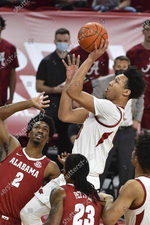 Arkansas forward Jaylin Williams (10) shoots over Alabama defender Alabama forward Jordan Bruner (2) during the first half of an NCAA college basketball game in Fayetteville, Ark
