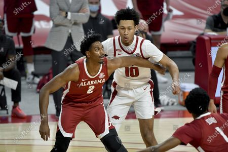 Alabama forward Jordan Bruner (2) and Arkansas forward Jaylin Williams (10) fight for position on a free throw during the first half of an NCAA college basketball game in Fayetteville, Ark