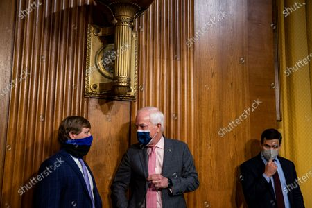 Sen. John Cornyn (R-TX) (C) arrives during the Senate Finance committee hearings to examine Katherine Tai's nomination to be United States Trade Representative, with the rank of Ambassador, in Washington, DC, USA, 25 February 2021.