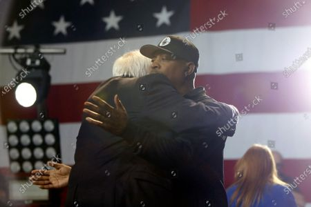 Rapper Chuck D gives a hug to Bernie Sanders as he enters the stage to perform during a Bernie Sanders rally at the Los Angeles Convention Center on March 1, 2020, in Los Angeles, California. (Photo By Dania Maxwell / Los Angeles Times)