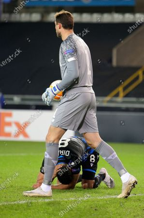 Stock Picture of Brugge's Nabil Dirar on the ground after a save by Dynamo Kyiv's goalkeeper Heorhiy Bushchan during the Europa League round of 32 second leg soccer match between Club Brugge and Dynamo Kyiv at the Bosuil stadium in Bruges, Belgium