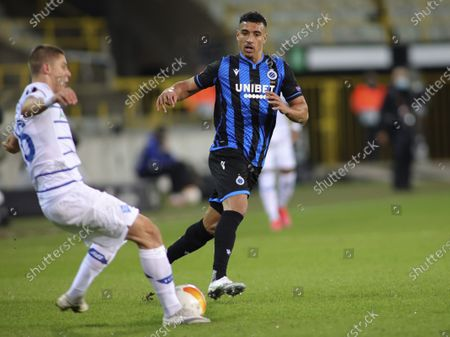 Brugge's Nabil Dirar, right, vies for the ball against Dynamo Kyiv's Vitaliy Mykolenko during the Europa League round of 32 second leg soccer match between Club Brugge and Dynamo Kyiv at the Bosuil stadium in Bruges, Belgium