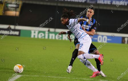 Stock Image of Brugge's Nabil Dirar, right, vies for the ball against Dynamo Kyiv's Gerson Rodrigues during the Europa League round of 32 second leg soccer match between Club Brugge and Dynamo Kyiv at the Bosuil stadium in Bruges, Belgium