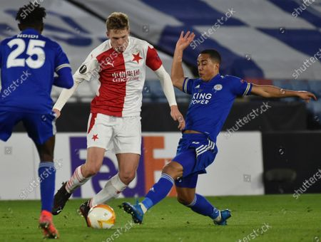 Stock Picture of Slavia's David Zima, center is challenged by Leicester's Youri Tielemans, right, during the Europa League round of 32 soccer match between Leicester City and Slavia Prague at the King Power Stadium in Leicester, England