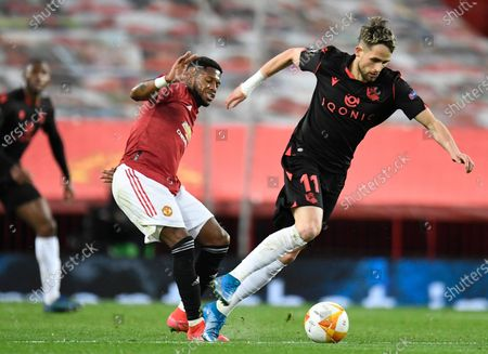 Real Sociedad's Adnan Januzaj (R) in action against Manchester United's Fred (L) during the UEFA Europa League round of 32, second leg soccer match between Manchester United and Real Sociedad in Manchester, Britain, 25 February 2021.