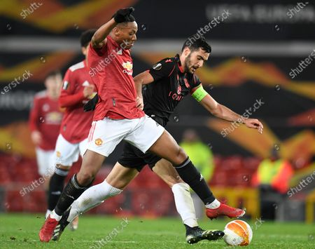 Manchester United's Anthony Martial (L) in action against Real Sociedad's Mikel Merino (R) during the UEFA Europa League round of 32, second leg soccer match between Manchester United and Real Sociedad in Manchester, Britain, 25 February 2021.