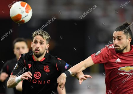 Real Sociedad's Adnan Januzaj (L) in action against Manchester United's Alex Telles (R) during the UEFA Europa League round of 32, second leg soccer match between Manchester United and Real Sociedad in Manchester, Britain, 25 February 2021.