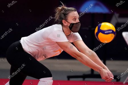 Outside hitter Jordan Larson, a two-time Olympic medalist with Team USA, reaches out to make a pass during volleyball practice in Dallas