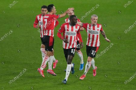 Players celebrate with Eran Zahavi, left with number 7, who scored his side's first goal during the Europa League round of 32 second leg soccer match between PSV and Olympiacos at the Philips stadium in Eindhoven, Netherlands