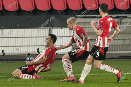 PSV's Eran Zahavi, left, celebrates with teammates Philipp Max, center, and Nick Viergever, right, after scoring his side's second goal during the Europa League round of 32 second leg soccer match between PSV and Olympiacos at the Philips stadium in Eindhoven, Netherlands