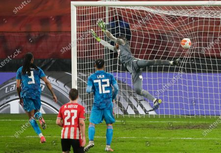 Olympiacos' goalkeeper Jose Sa fails to stop a free kick PSV's Eran Zahavi who scored his side's second goal during the Europa League round of 32 second leg soccer match between PSV and Olympiacos at the Philips stadium in Eindhoven, Netherlands