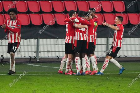 Players celebrate with Eran Zahavi who scored his side's second goal during the Europa League round of 32 second leg soccer match between PSV and Olympiacos at the Philips stadium in Eindhoven, Netherlands