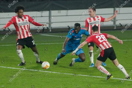 Olympiacos' Mady Camara, center, is tackled by PSV's Mario Goetze, rear, as PSV's Pablo Rosario, left, and Olivier Boscagli, right, block the passage during the Europa League round of 32 second leg soccer match between PSV and Olympiacos at the Philips stadium in Eindhoven, Netherlands