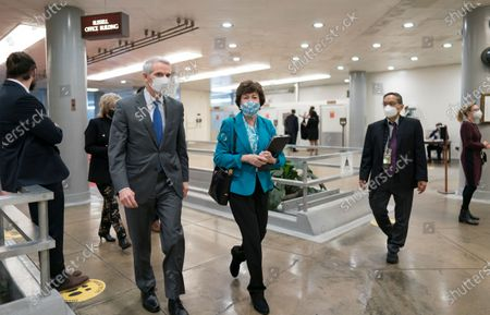 Stock Image of Sen. Rob Portman, R-Ohio, left, and Sen. Susan Collins, R-Maine, arrive for votes on President Joe Biden's cabinet nominees, at the Capitol in Washington