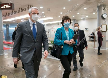 Stock Picture of Sen. Rob Portman, R-Ohio, left, and Sen. Susan Collins, R-Maine, arrive for votes on President Joe Biden's cabinet nominees, at the Capitol in Washington