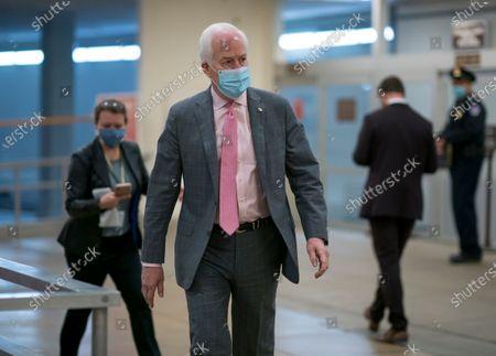 Sen. John Cornyn, R-Texas, arrives for votes on President Joe Biden's cabinet nominees, at the Capitol in Washington