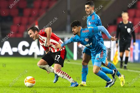 Mario Goetze (L) of Eindhoven in action against Thanasis Androutsos (R) of Olympiacos during the UEFA Europa League round of 32, second leg soccer match between PSV Eindhoven and Olympiacos Piraeus in Eindhoven, Netherlands, 25 February 2021.
