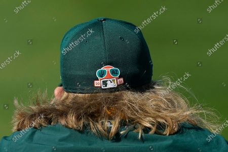 Oakland A's pitcher Jordan Weems watches during a spring training baseball practice, in Mesa, Ariz