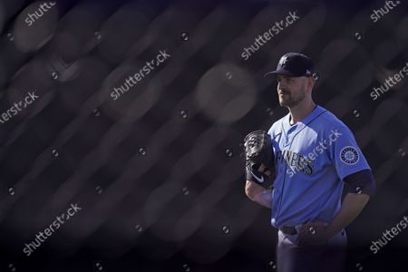 Seattle Mariners pitcher James Paxton waits to throw during baseball spring training, in Peoria, Ariz