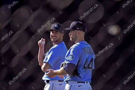 Stock Image of Seattle Mariners pitchers James Paxton, right, and Brady Lail wait to throw during baseball spring training, in Peoria, Ariz