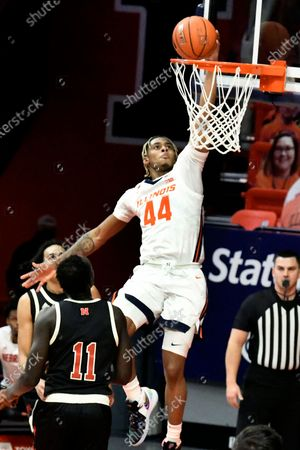 Illinois guard Adam Miller (44) lays the ball in as Nebraska forward Lat Mayen (11) defends during the second half of an NCAA college basketball game, in Champaign, Ill