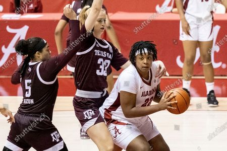 Alabama forward Ariyah Copeland (22) works against a double-team of Texas A&M guard Jordan Nixon (5) and center Anna Dreimane (33) during the second half of an NCAA college basketball game, in Tuscaloosa, Ala