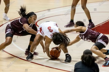 Alabama guard Jordan Lewis (3) grabs for the ball as Texas A&M guards Aaliyah Wilson, left, and Alexis Morris, right, attack during the second half of an NCAA college basketball game, in Tuscaloosa, Ala
