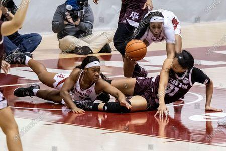 Alabama forward Jasmine Walker (40) grabs the ball that Alabama guard Jordan Lewis (3) and Texas A&M forward N'dea Jones (31) were chasing during the second half of an NCAA college basketball game, in Tuscaloosa, Ala