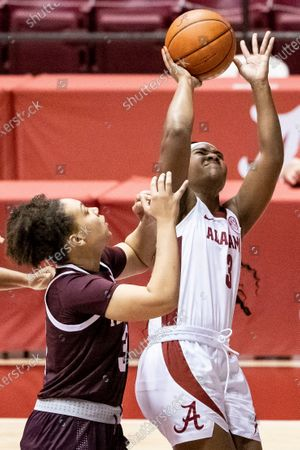 Alabama guard Jordan Lewis (3) shoots with Texas A&M guard Destiny Pitts (3) defending during the second half of an NCAA college basketball game, in Tuscaloosa, Ala