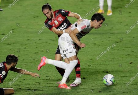 Sao Paulo's Pablo, right, and Flamengo's Filipe Luis battle for the ball during the Brazilian championship final soccer match at the Morumbi stadium, Sao Paulo, Brazil