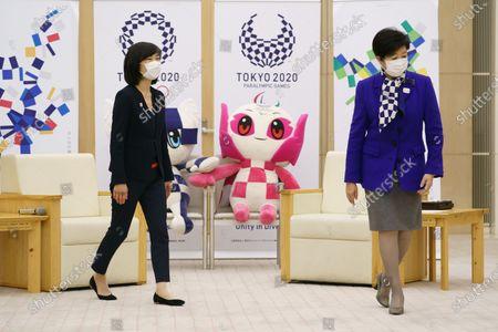 Japanese Olympic Minister Tamayo Marukawa speaks with Tokyo Gov Yuriko Koike at the Tokyo Metropolitan Government office in Tokyo, Japan.