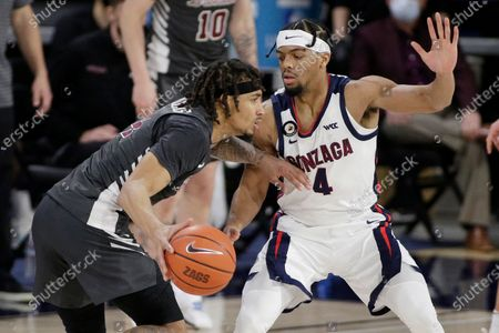 Santa Clara guard Giordan Williams, left, drives while pressured by Gonzaga guard Aaron Cook during the second half of an NCAA college basketball game in Spokane, Wash