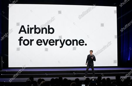 Airbnb co-founder and CEO Brian Chesky speaks during an event in San Francisco. Activists and lawyers are targeting the IOC's most high-profile sponsors tied to next year's Beijing Winter Olympics as a way to bring light to human rights abuses in China against Muslim Uyghurs and other ethnic minorities. The top 15 IOC sponsors are household names that include Coca-Cola, Toyota, Visa, Samsung, General Electric, and Airbnb among others