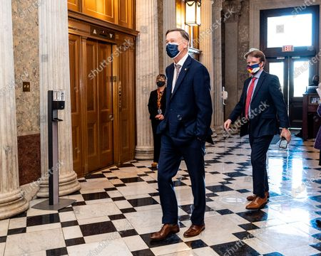 U.S. Senator John Hickenlooper (D-CO) walks towards the Senate Chamber.