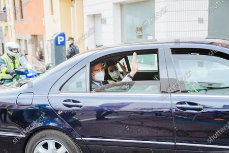 Stock Photo of King of Spain, Felipe VI (Felipe Jaun Pablo) and Queen of Spain, Letizia Ortiz Rocasolano, waving to supporters as the they leave, during the inauguration. The Helga Museum, a contemporary art housing one of the most important collections in Europe has been inaugurated by the Royal family of Spain after more than 7 years of work. Just 10 meters from the museum, a protest against the monarchy was organized by some people.
