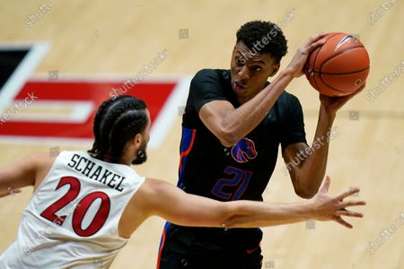 San Diego State guard Jordan Schakel (20) defends against Boise State guard Derrick Alston Jr. (21) during the second half of an NCAA college basketball game, in San Diego